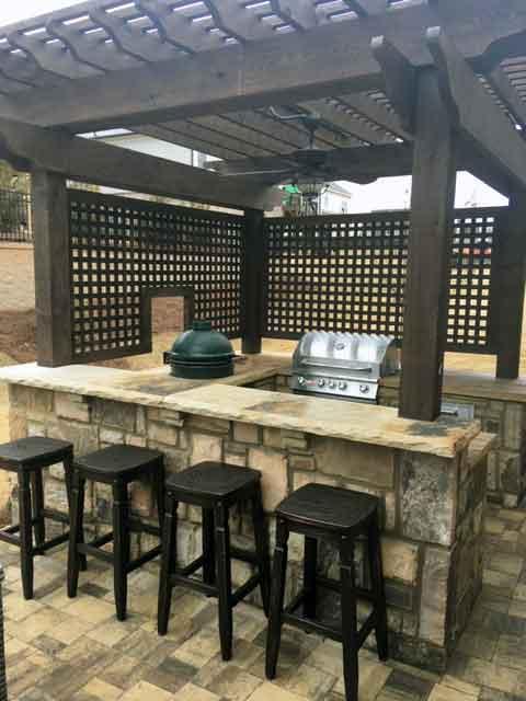 outdoor stone bar with custom built wood pergola